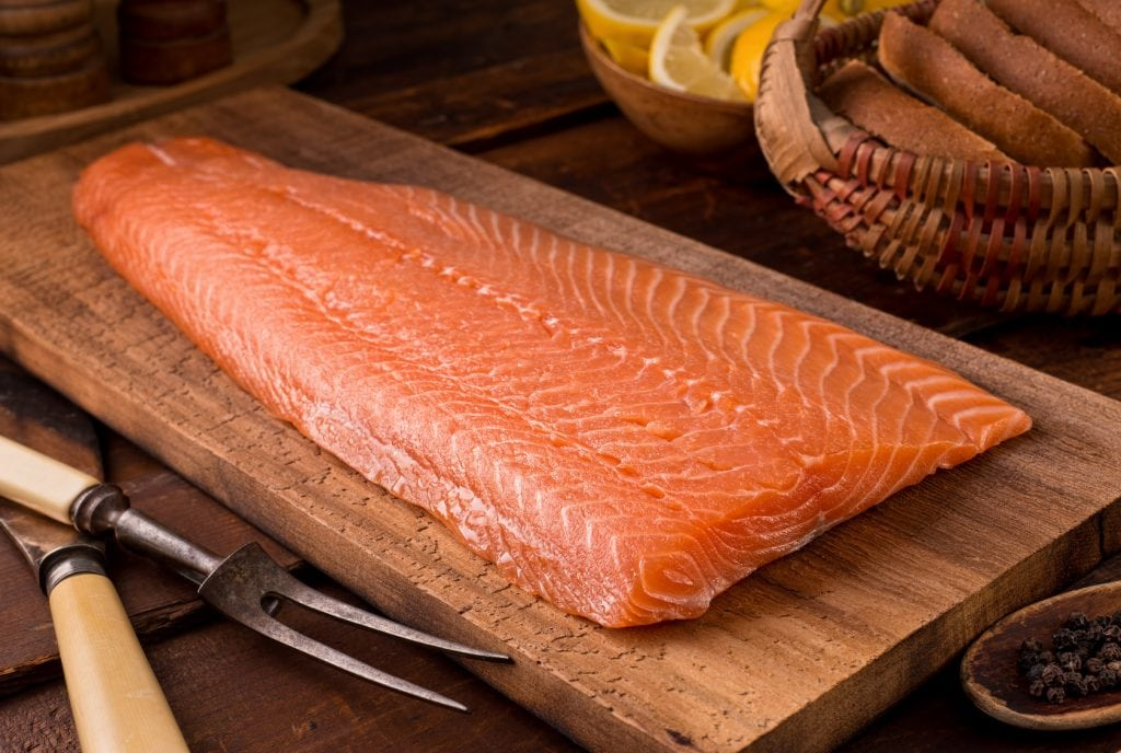 A delicious salmon fillet on a cedar plank.
